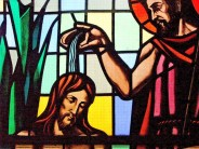 A stained glass window depicting Jesus' baptism as affusion (photo credit: stainedglasscanada.ca)