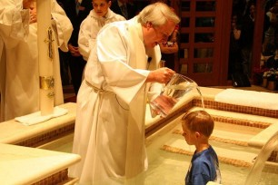 Baptism through Affusion (or pouring) (Photo credit: Rick Hogaboam - totascriptura.com)